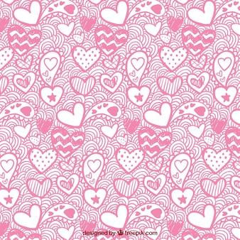 Le motif de la saint-valentin de coeurs dessinés à la main