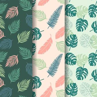 Motif sans couture de feuilles tropicales