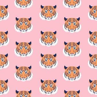 Motif tendance sans couture de tête de tigre. contexte de l'année du tigre 2022.