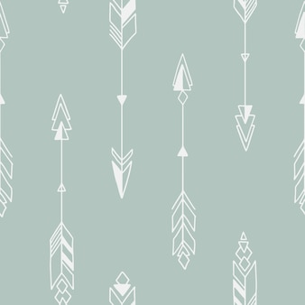 Motif tribal géométrique dessiné à la main sans couture avec des flèches.