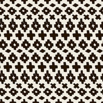 Motif tribal sans soudure dessiné à la main de vecteur. modèle sans couture ethnique abstrait en monochrome. forme géométrique de fond sans fin. texture pour l'impression sur textiles, couvertures de cahiers et conception de sites web