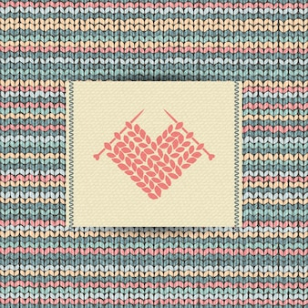 Motif tricoté en laine avec broderie cœur