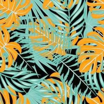 Motif tropical de feuilles dessinées de palme et de monstera