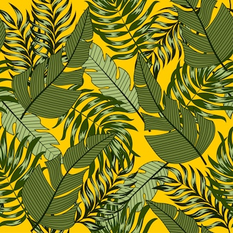 Motif tropical sans soudure botanique avec des plantes et des feuilles lumineuses sur fond jaune