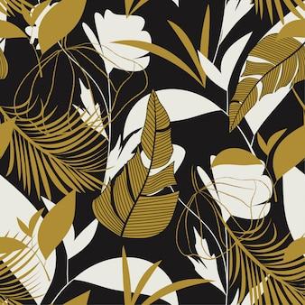 Motif tropical sans soudure tendance avec des feuilles, des fleurs et des plantes aux couleurs vives