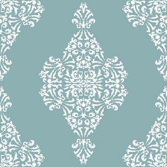 Motif victorien vintage blanc sur fond gris-vert pastel damassé géométrique décoratif