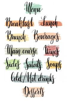 Mots pour le menu du restaurant à la main sur des taches texturées.