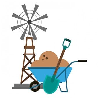 Moulin à vent et brouette avec sol