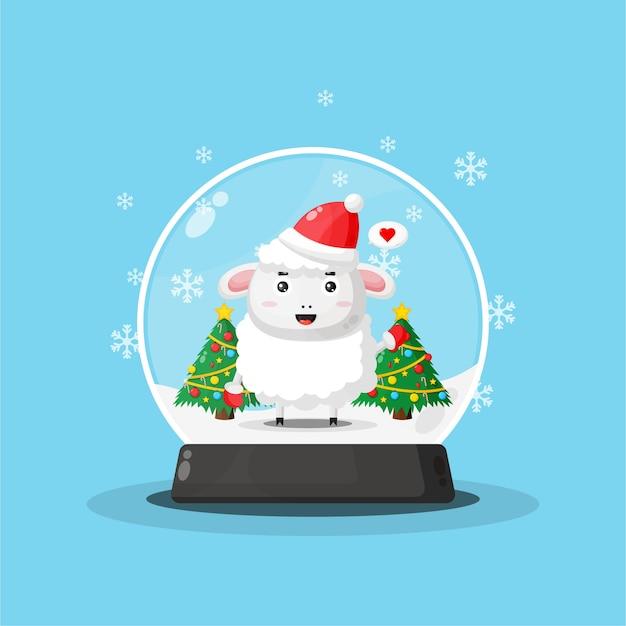 Mouton mignon dans une boule à neige