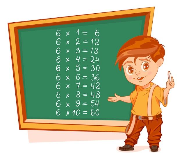 Multiplication par 6 table garçon écolier stand par tableau noir avec craie