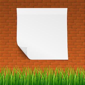 Mur de brique rouge avec bannière propre et herbe