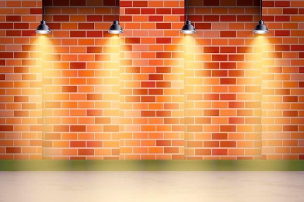 Mur de briques de fond de projecteurs et herbe