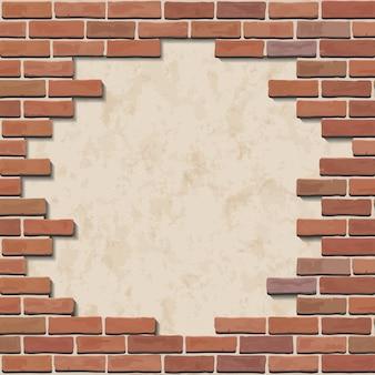 Mur de briques rouges endommagé avec trou.