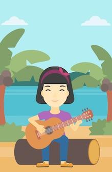 Musicien jouant de la guitare acoustique.