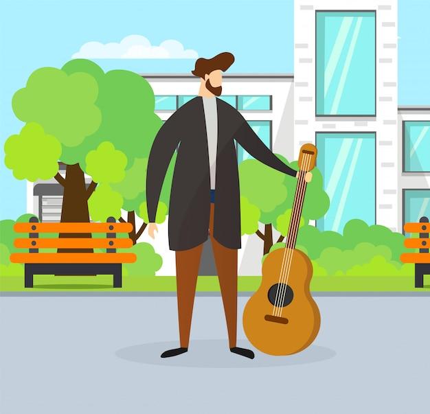 Musicien talentueux tenant une guitare dans la rue.