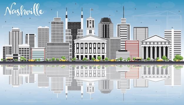 Nashville skyline avec bâtiments gris, ciel bleu et reflets.
