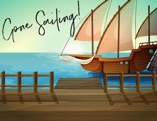 Navire à quai avec la phrase a quitté la voile