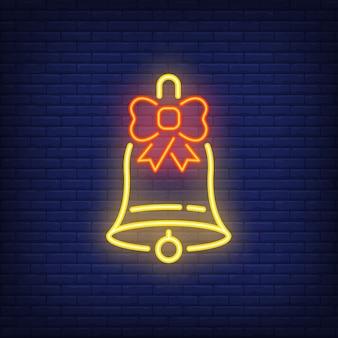 Neon cloche de noël avec archet. élément festif. concept de célébration
