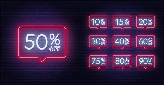 Neon discount light signes sur un fond sombre.