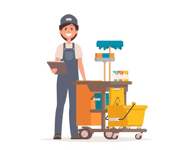 Nettoyeur professionnel femme avec chariot de nettoyage