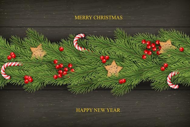 Noël sur bois sombre avec des voeux, branches de pin.