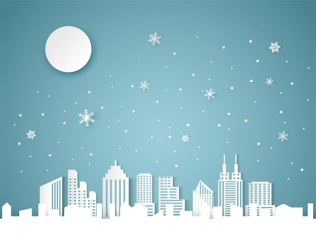 Noël et bonne année fond bleu avec paysage urbain et flocon de neige