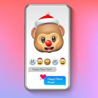 Noël emoji singe dans le chapeau du père noël, émoticône visage sourire vacances