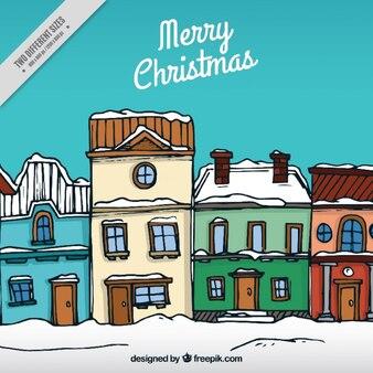 Noël fond de la main maisons avec de la neige dessinée