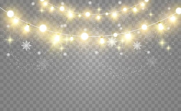 Noël lumineux, belles lumières, éléments de conception. lumières incandescentes pour la conception de cartes de voeux de noël. guirlandes, décorations lumineuses.