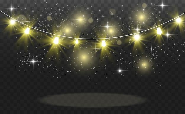 Noël lumineux, belles lumières, éléments. lumières incandescentes pour des cartes de voeux de noël. guirlandes, décorations de noël légères.