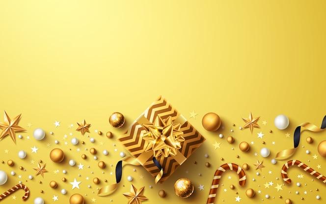 Noël et nouvel an fond doré avec boîte-cadeau dorée et décoration de noël