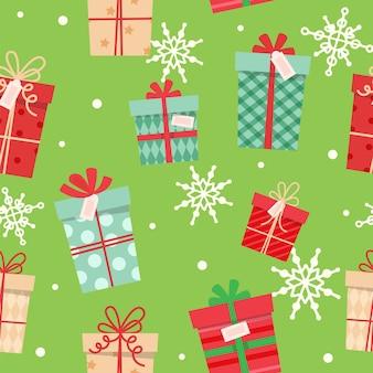 Noël présente un modèle sans couture, différentes boîtes avec des rubans.