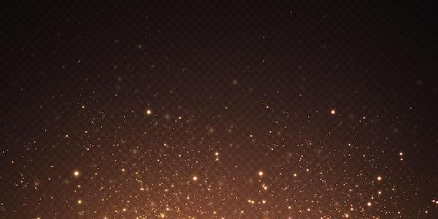 Noël tombant des lumières dorées. poussière d'or abstraite magique et éblouissement. fond de noël festif. particules dorées abstraites et paillettes sur fond noir.