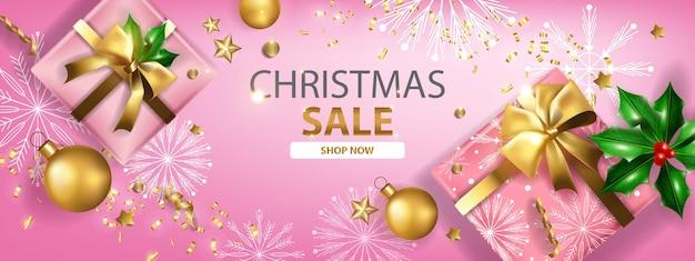 Noël vente vacances bannière vecteur noël remise promotion fond boîte-cadeau boule d'or