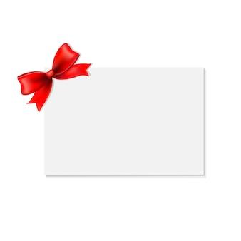 Noeud rouge et étiquette cadeau vierge,