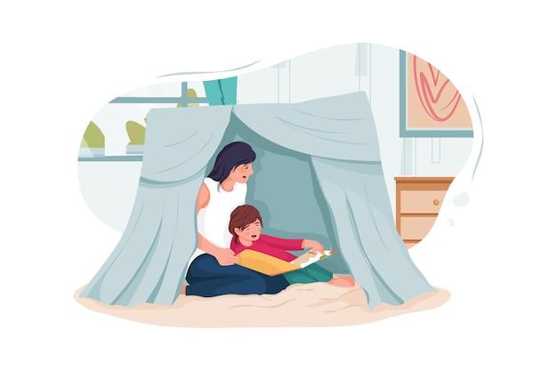 Nounou et petits enfants lisant un livre dans une tente à la maison