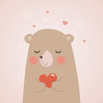 Nounours mignon tient un coeur
