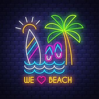 Nous aimons la plage. inscription au néon