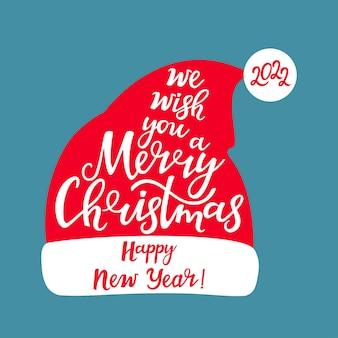 Nous vous souhaitons un joyeux noël et une bonne année main lettrage chapeau de père noël