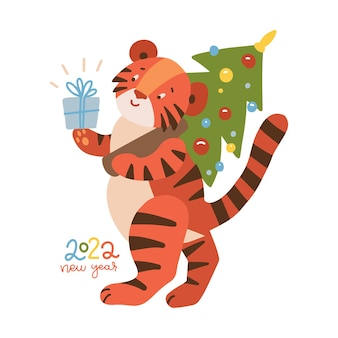 Nouvel an et joyeux noël mascotte tigre personnage drôle avec boîte-cadeau tenant un sapin de noël décoré ...