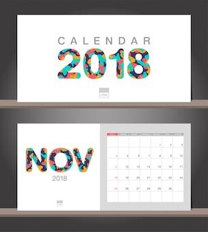 Novembre 2018 calendrier. modèle de conception moderne de calendrier de bureau avec des styles de papier découpé