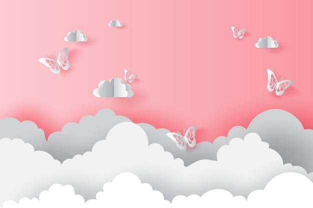 Nuage avec des papillons sur la saint-valentin rose