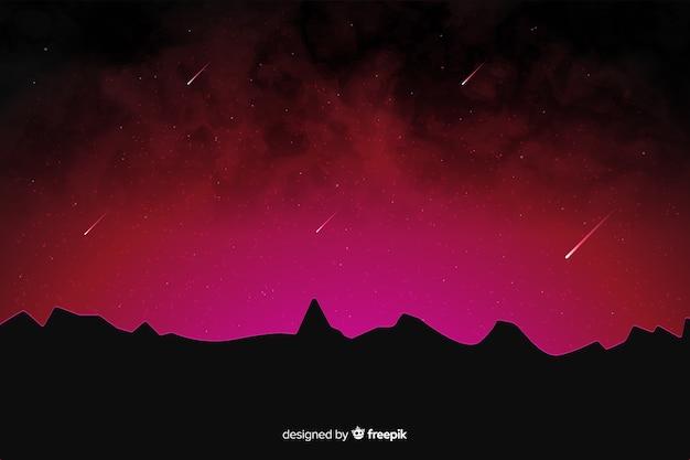 Nuances rouges d'une nuit avec des étoiles filantes