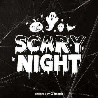 Nuit effrayante lettrage avec fantôme