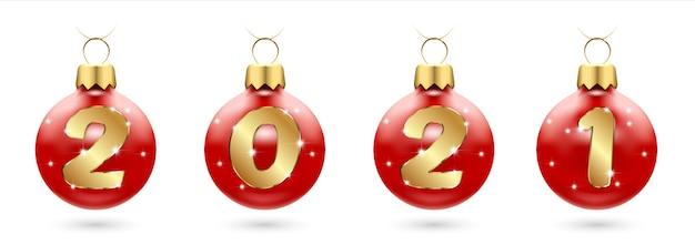 Numéros de confettis dorés en boules de noël rouges festive, nouvel an