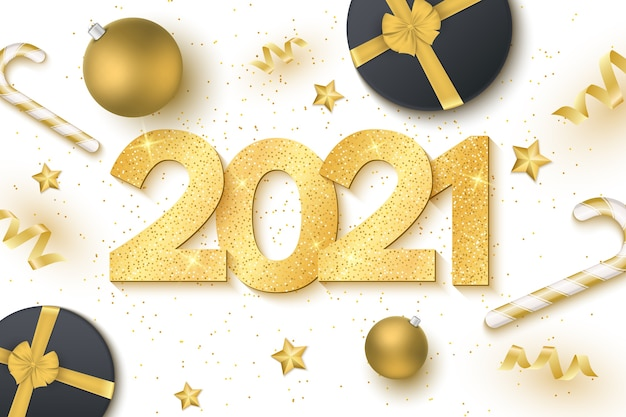 Numéros luxueux dorés avec paillettes, sucette, serpentine, boules festives et étoiles sur fond blanc pour bonne année. boite cadeau. carte de voeux.