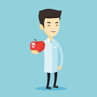Nutritionniste offrant une pomme rouge fraîche.