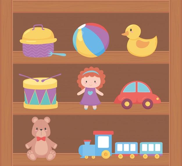 Objet de jouets pour les petits enfants à jouer au dessin animé sur une étagère en bois