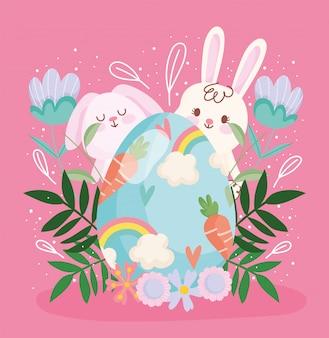 Oeuf de lapin mignon joyeuses pâques avec carottes et décoration florale arc-en-ciel
