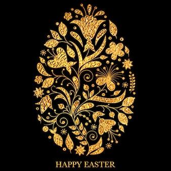 Oeuf de pâques floral avec texture dorée sur fond noir.